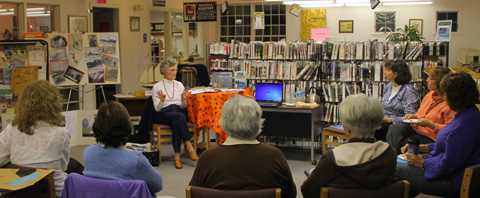 Talking to group at Windham, ME, library